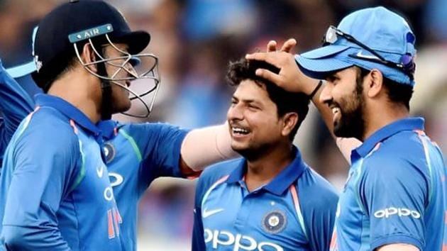 File image of Kuldeep Yadav (C) celebrating the fall of a wicket with his teammates.(PTI)
