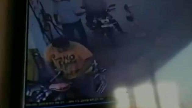 A young man's motorcycle caught fire when he started it after filling up his petrol tank in Tamil Nadu's Tirunelveli.(ANI/Video screenshot)