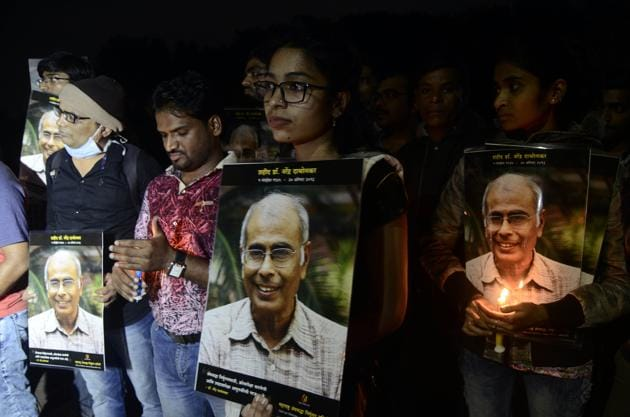 Pune, India - August 18, 2018: Andhashraddha Nirmulan Samiti volunteers lit up candles in the eve of 4th year completion of Dr Narendra Dabholkar murder at Shinde bridge in Pune, India, on Sunday, August 19, 2018. (Photo by Ravindra Joshi)(HT Photo)