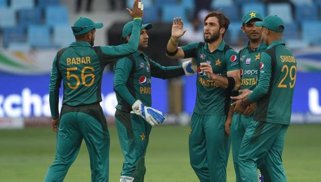 Usman Shinwari (centre) picked three wickets against Hong Kong on Sunday.(ICC/Twitter)