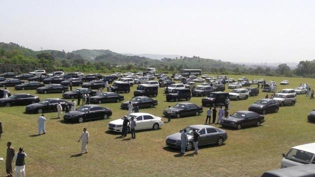 People visit an auction of government owned used cars at the premises of Prime Minister House in Islamabad.(Reuters Photo)