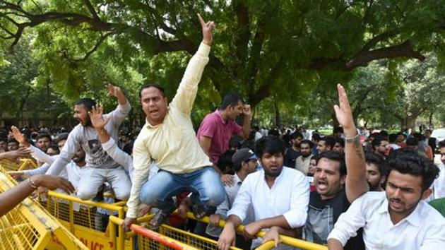 Candidates protest during the counting of votes for Delhi University Students Union (DUSU) election, at counting centre, New Police Line, in New Delhi, India.(HT Representative Photo)