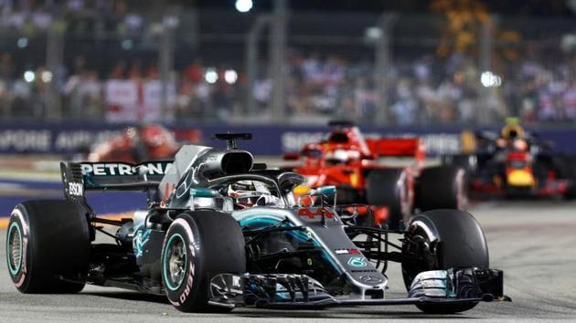 Mercedes' Lewis Hamilton leads during the race.(REUTERS)