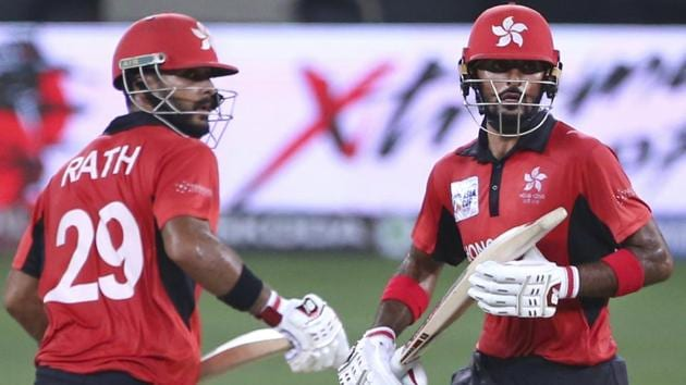 Hong Kong's captain Anshuman Rath, left, and Nizakat Khan run between the wickets during the one day international cricket match of Asia Cup.(AP)