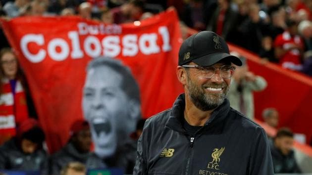 Liverpool manager Juergen Klopp smiles after their win over PSG on Tuesday.(REUTERS)