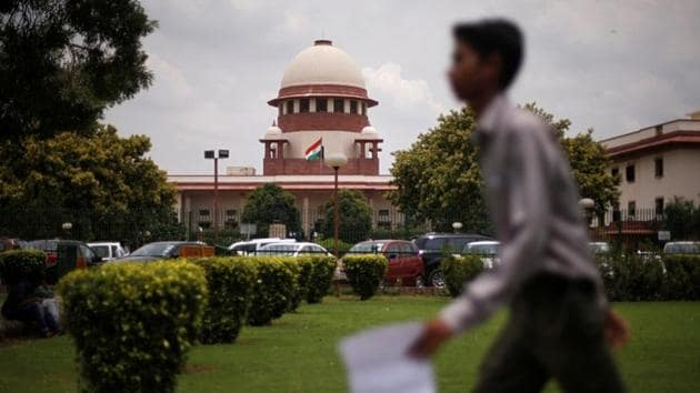 A man walks inside the premises of the Supreme Court in New Delhi, India, July 17, 2018.(REUTERS)