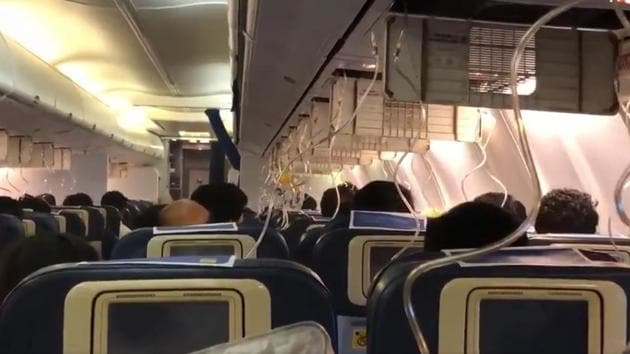 A screengrab of a video posted by a passenger shows oxygen masks were deployed inside the Jet Airways flight after cabin pressure dropped.(Darshak Hathi/Twitter)