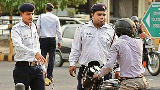 The Delhi Traffic Police has started a crackdown on lane violations to make commuting safer. In the last three months, the traffic department fined 563 drivers for moving across lanes, as part of a special drive.(Raj K Raj/HT file PHOTO)