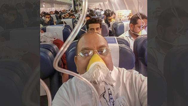 Passengers on board the Mumbai-Jaipur Jet Airways flight wear oxygen masks during an emergency after cabin pressure drop, in Mumbai.(PTI Photo)