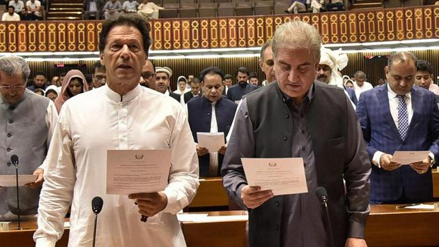 Newly elected parliamentarian Imran Khan (left) takes the oath of office with Shah Mehmood Qureshi, in Islamabad, Pakistan, on August 13, 2018.(AP)