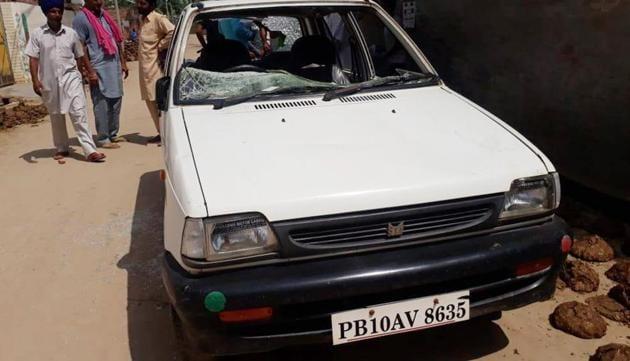 A car damaged in violence at Dullewala village in Bathinda on Wednesday.(Sanjeev Kumar/HT)