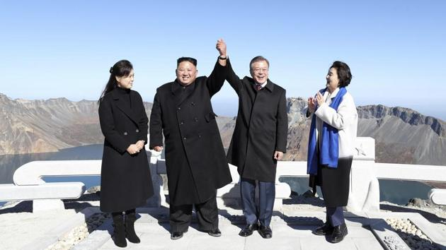 <p>South Korean President Moon Jae-in (2nd-R), and his wife Kim Jung-sook (R), stand with North Korean leader Kim Jong Un (2nd-L), and his wife Ri Sol Ju on...
