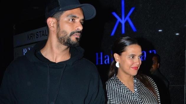 Neha Dhupia along with her husband Angad Bedi seen at Mumbai's Bandra.(IANS)