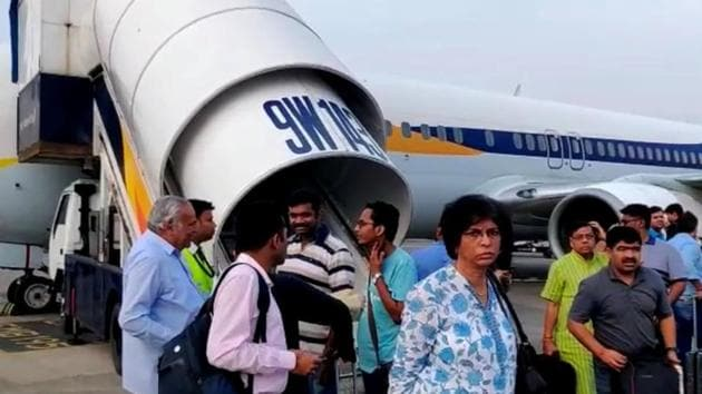 Passengers stand on the tarmac after an emergency landing, due to lost cabin pressure, on a Jet Airways flight, in Mumbai, September 20(REUTERS)