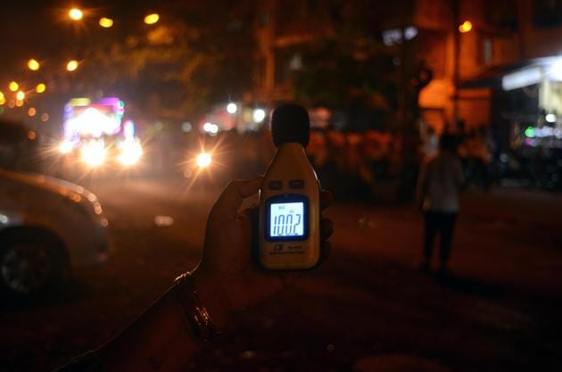 Sarita Khanchandani, the founder of NGO Hirali Foundation, holds up a sound meter to measure noise levels in Ulhasnagar.(HT Photo)