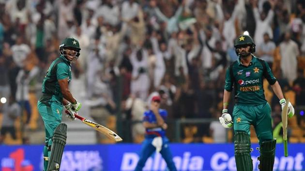 Pakistan's Hasan Ali (L) celebrates at the end of the match during the one day international (ODI) Asia Cup cricket match between Pakistan and Afghanistan at The Sheikh Zayed Stadium in Abu Dhabi.(AFP)