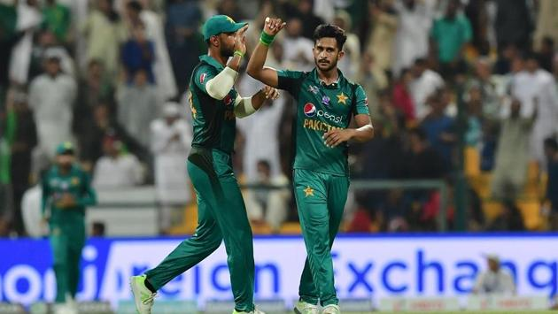 Pakistan's Hasan Ali (R) celebrates after he dismissed Afghanistan batsman Najibullah Zadran during the one day international (ODI) Asia Cup cricket match between Pakistan and Afghanistan.(AFP)