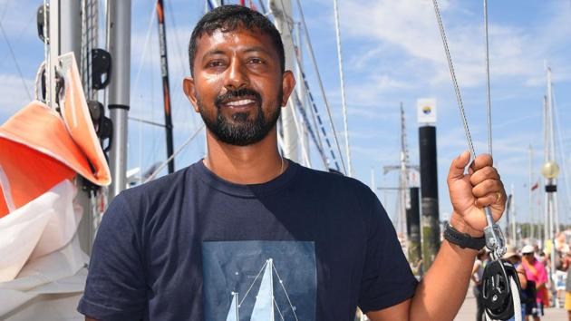 Abhilash Tomy poses on his boat 'Thuriya' in Les Sables d'Olonne Harbour, on June 29, 2018, ahead of the solo around-the-world sailing race for the 'Golden Globe Race' ocean race in which sailors compete without high technology aides such as GPS or computers.(AFP)