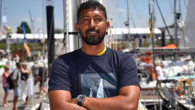 """Abhilash Tomy poses on his boat """"Thuriya"""" in Les Sables d'Olonne Harbour, on June 29, 2018, ahead of the solo around-the-world sailing race for the """"Golden Globe Race"""" ocean race in which sailors compete without high technology aides such as GPS or computers.(AFP)"""