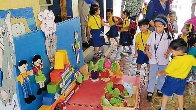 Preschools under the Podar Jumbo Kids umbrella encourage students to play games on nutrition.(HT PHOTO)