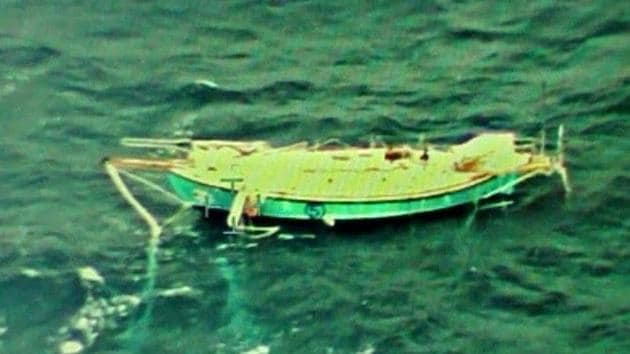 Indian Navy Ace Sailor Abhilash Tomy who was injured and incapacitated day before has been tracked by the Indian Navy Reconnaissance aircraft. As seen, Boat Mast broken and hanging on the side, said Navy.(ANI/Twitter)