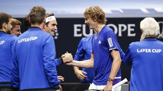 Team Europe's Alexander Zverev, second from right, is congratulated by Rodger Federer after defeating Team World's John Isner at the Laver Cup tennis event, Saturday, Sept. 22, 2018, in Chicago. (AP Photo/Kamil Krzaczynski)(AP)