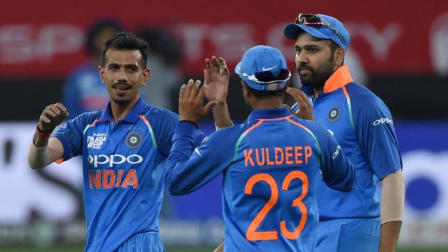 Indian cricketer Yuzvendra Chahal (C) celebrates with teammates after he dismissed Pakistan batsman Asif Ali during the one day international (ODI) Asia Cup cricket match between Pakistan and India(AFP)