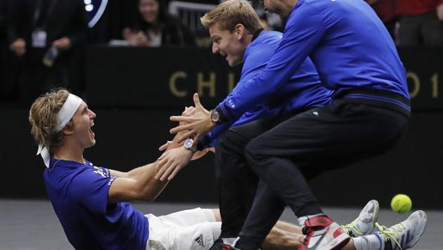 Team Europe's Alexander Zverev, left, celebrates with teammates David Goffin, center, and Grigor Dimitrov after defeating Team World's Kevin Anderson during a men's singles tennis match to win the Laver Cup(AP)
