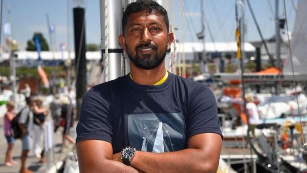 Abhilash Tomy poses on his boat 'Thuriya' in Les Sables d'Olonne Harbour, on June 29, 2018, ahead of the solo around-the-world sailing race.(AFP File Photo)