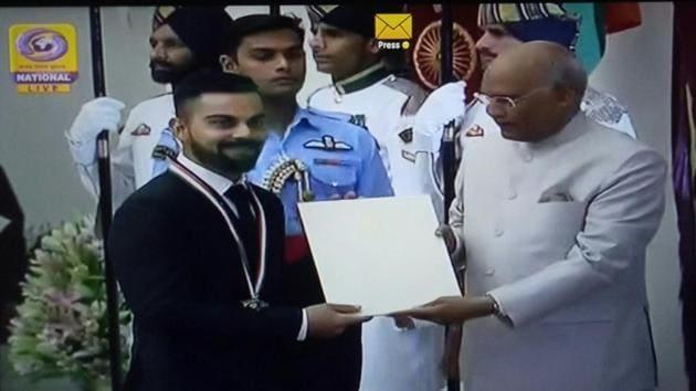 Television grab of Indian cricket captain Virat Kohli receiving Khel Ratna Award from President of India Ram Nath Kovind.(Twitter)