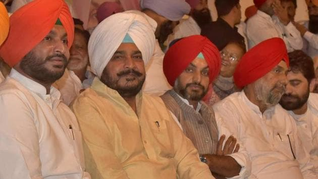 (From left) MP Ravneet Bittu and state minister Sadhu Singh Dharamsot with other Congress leaders during the party's annual conference at Chhapar village in Ludhiana on Monday.(HT Photo)