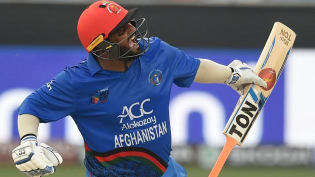 Afghan batsman Mohammad Shahzad celebrates after scoring a century (100 runs) during the one day international (ODI) Asia Cup cricket match between Afghanistan and India at the Dubai International Cricket Stadium in Dubai on September 25, 2018.(AFP)