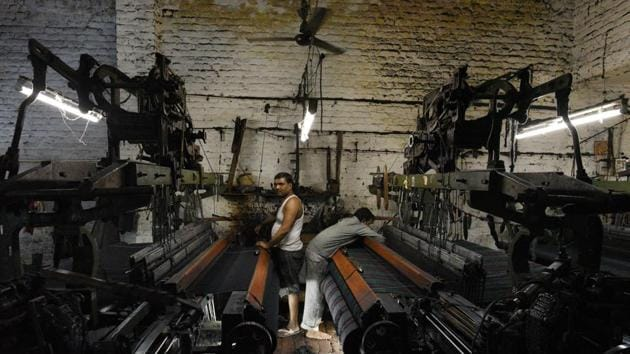 Workers at a small factory who make shoddy blanket in Panipat on April 19.(Vipin Kumar/HT PHOTO)