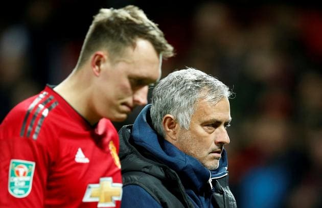 Manchester United's Phil Jones and manager Jose Mourinho look dejected after Derby County win the penalty shootout(REUTERS)