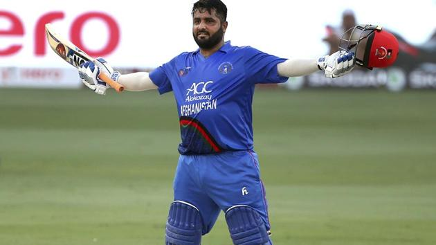 Afghanistan's Mohammad Shahzad celebrates scoring a century during the one day international cricket match of Asia Cup between India and Afghanistan(AP)