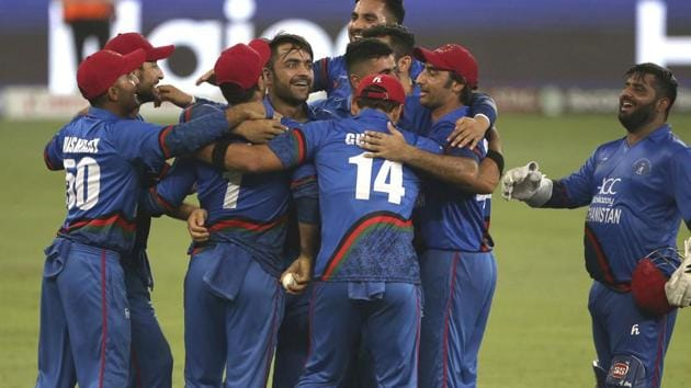 Afghanistan players celebrate the dismissal of India's Ravindra Jadeja during the one day international cricket match of Asia Cup between India and Afghanistan in Dubai.(AP)