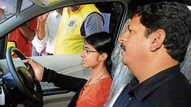 Jilumol Mariet Thomas procured an order from Kerala high court to apply for licence to drive car with her legs.(By special arrangement)