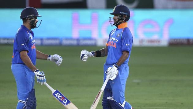 India's captain Rohit Sharma, left, and Shikhar Dhawan greet each other during the one day international cric, Sunday, Sept. 23, 2018. (AP Photo/Aijaz Rahi)(AP)