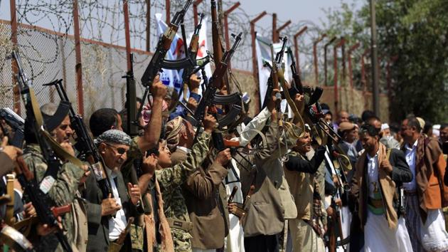 Tribal gunmen loyal to the Huthi rebels brandish their weapons during a gathering in Sanaa.(AFP)