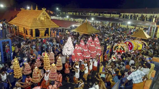 Following a five-judge constitution bench of the apex court deciding 4:1 on Friday to lift the ban on women aged between 10 and 50, the TDB said it was expecting a 30 per cent hike in devotees during the three-month pilgrimage season starting in November.(HT Photo)