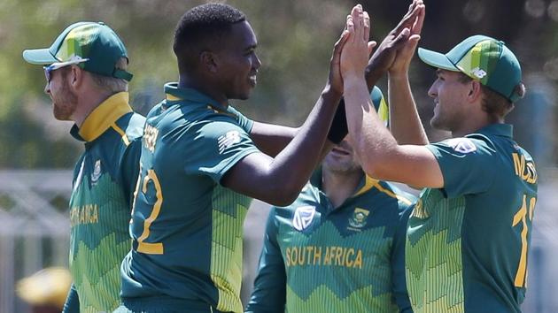 South Africa's Lungi Ngidi (L) celebrates after dismissing Zimbabwe's Kyle Jarvis during the first One Day International.(AFP)