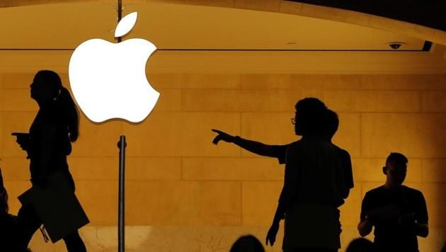 Customers walk past an Apple logo inside of an Apple store at Grand Central Station in New York.(Reuters File Photo)