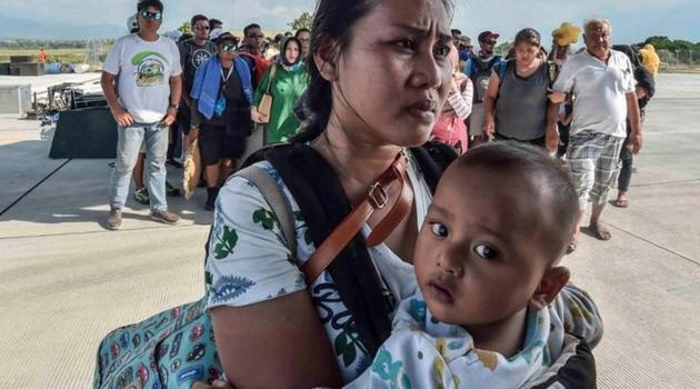 People injured or affected by the earthquake and tsunami wait to be evacuated on an air force plane in Palu, Central Sulawesi, Indonesia.(Antara Foto via Reuters)