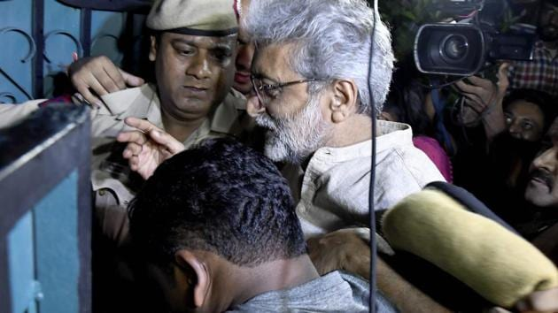 Human rights activist Gautam Navlakha at his residence after he was arrested by the Pune police in connection with the Bhima Koregaon violence, in New Delhi on Tuesday.(PTI File Photo)