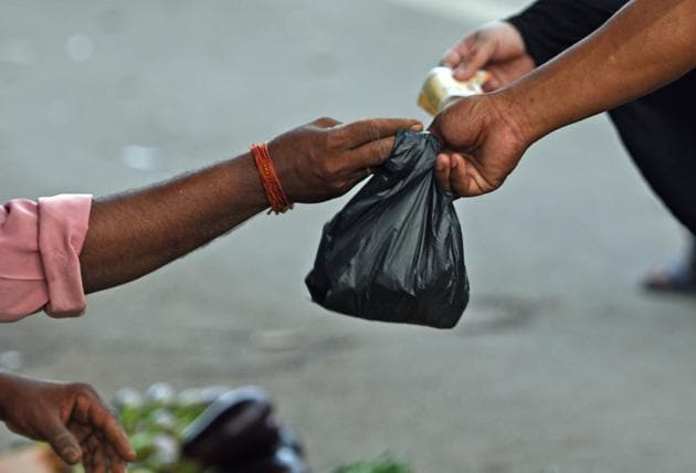 Shopkeepers use plastic bags after the statewide ban in Bandra.(HT Photo)