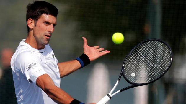Serbia's tennis player Novak Djokovic returns the ball during a training session in Belgrade.(AFP)