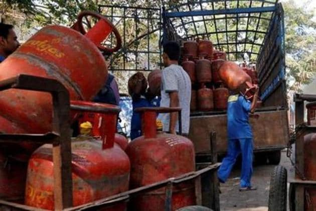 Workers load liquefied petroleum gas (LPG) cooking cylinders onto a supply truck. Image for representation.(Reuters file photo)