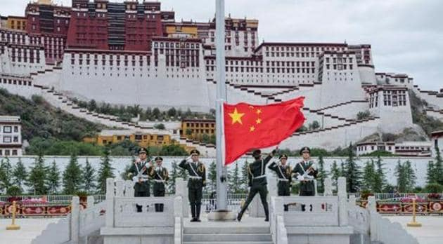 The Chinese national flag is raised during a ceremony marking the 96th anniversary of the founding of the Communist Party of China (CPC) at Potala Palace in Lhasa, Tibet Autonomous Region, China, in July 2017.(Reuters File Photo)