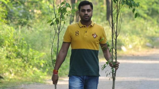 In six years, Amit Rathi and villagers of Gairatpur Baas have planted more than 30,000 saplings of indigenous trees in the Aravallis.(Parveen Kumar / HT Photo)
