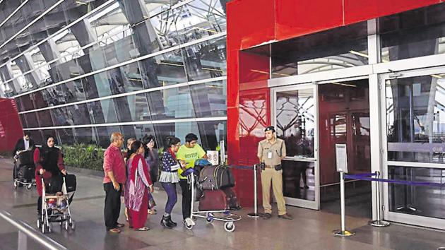 CISF security personnel check people entering the Delhi airport. Bengaluru and Hyderabad airports will be ready for Digi Yatra implementation on pilot basis by March next year.(HT File Photo)